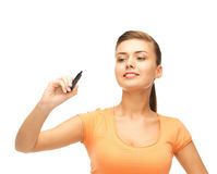 Woman writing something in the air. With marker Royalty Free Stock Photography