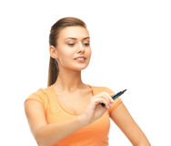 Woman writing something in the air. With marker Stock Photo