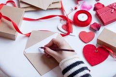Woman writing something on envelope Stock Image
