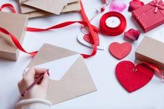Woman writing something on envelope Royalty Free Stock Photo