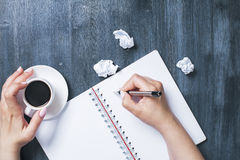 Woman writing in spiral notepad Royalty Free Stock Photography