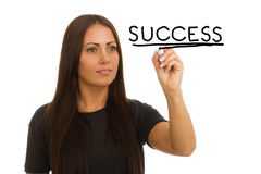Woman writing succes Royalty Free Stock Photography