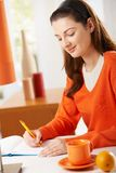Woman writing to diary Royalty Free Stock Image
