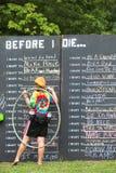 Woman Writing on Wish List Chalkboard Stock Photo