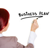 Woman writing the word Business Stock Photography