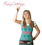 Woman writting Merry Christmas. Isolated on white background Royalty Free Stock Image