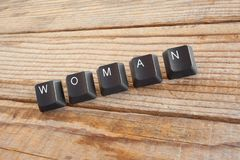 WOMAN wrote with keyboard keys on wooden background Stock Image