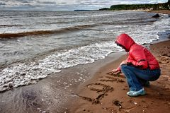 A woman wrote in the sand Stock Photography