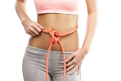 Woman's abdomen tied with a rope Royalty Free Stock Photography
