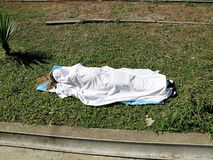 Woman's body under the bedsheet Stock Images