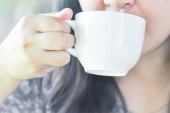 Woman's drinking some coffee or hot coffee Royalty Free Stock Image