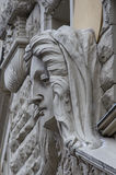 Woman's face sculpture. Art Nouveau house facade decoration in R Royalty Free Stock Image