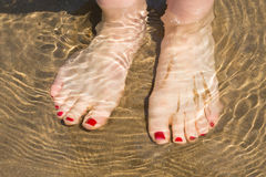 Woman's feet under water Royalty Free Stock Images