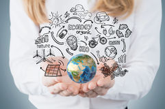 Woman's hand holding globe against blackboard Royalty Free Stock Images