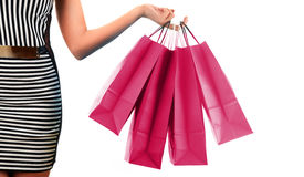 Woman's hand holding paper shopping bags isolated on white Stock Image