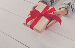 Woman's hands give christmas gift in present box Royalty Free Stock Images