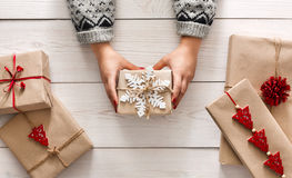 Woman's hands show christmas holiday present with craft twine Royalty Free Stock Photography