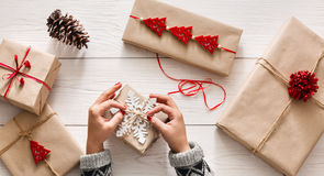 Woman's hands wrapping christmas holiday present with craft twine Royalty Free Stock Images