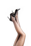Woman& x27;s Legs Wearing Pantyhose and High Heels Stock Photos