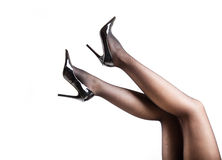 Woman& x27;s Legs Wearing Pantyhose and High Heels Royalty Free Stock Image