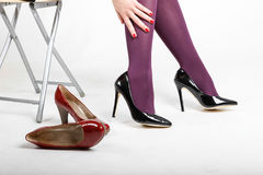 Woman& x27;s Legs Wearing Pantyhose and High Heels Stock Photography