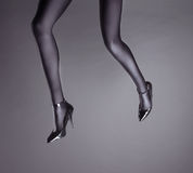 Woman& x27;s Legs Wearing Spandex Pantyhose and High Heels Royalty Free Stock Photos