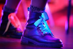 Woman's boot in neon lights