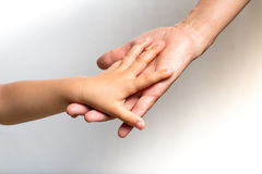 Woman& X27;s Hand Holding A Child& X27;s Hand Royalty Free Stock Image