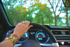 Woman's hands driving car Royalty Free Stock Image