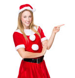 Woman with Xmas dress and finger point aside Stock Image