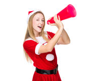 Woman with xmas dress yell with megaphone Foto de archivo