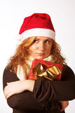Woman with a xmas gift Stock Image
