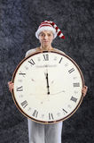 Woman with xmas hat and midnight clock Stock Images