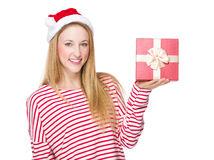 Woman with Xmas hat and show with gift box Stock Photos