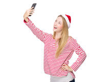 Woman with xmas hat and take selfie Stock Photography