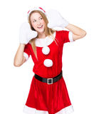 Woman with xmas party dress and listen something Royalty Free Stock Photo