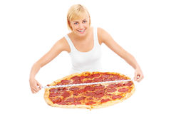 Woman with xxl pizza Royalty Free Stock Photography