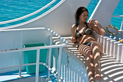 Woman on the yacht Stock Images