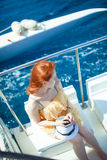 The woman on the yacht on background of ocean Stock Photography