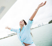 Woman in a yacht enjoying her freedom Royalty Free Stock Image