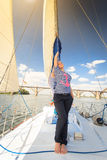 Woman on the yacht Stock Photos