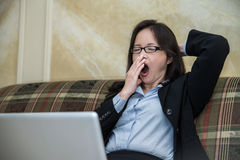 Woman yawing on sofa Royalty Free Stock Photography