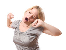 Woman yawning stock photography