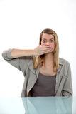 Woman yawning Stock Images