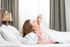 Woman yawning in the bed royalty free stock image