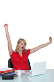 Woman yawning at a desk Stock Photo