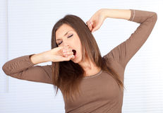 Woman yawning and stretching Royalty Free Stock Image