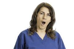Woman Yawning Wearing Scrubs Royalty Free Stock Photos