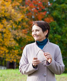 Woman 50 years in the autumn park Royalty Free Stock Photo