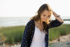 Woman 30-40 years dressed in boho style. Holding herself by the head stock photo